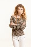 Attractive young woman standing arms crossed Royalty Free Stock Photo
