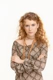 Attractive young woman standing arms crossed Stock Photography