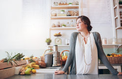 Attractive young woman standing behind the counter Royalty Free Stock Images