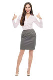 Attractive young woman standing with thumbs up Stock Image