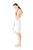 Attractive young woman standing in a towel. Stock Photo