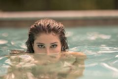 Attractive Young Woman Sticking Her Head Out Of The Water Stock Photography