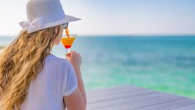 Attractive young woman in straw hat enjoy in sunny summer day with cocktail stock photos