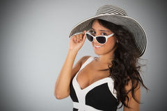 Attractive young woman with straw hat and sunglasses Stock Photo