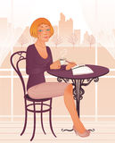 Attractive young woman in street cafe Royalty Free Stock Photos