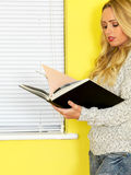 Attractive Young Woman Student Reading a Book Stock Images
