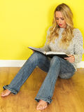Attractive Young Woman Student Reading a Book Stock Photo