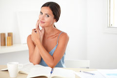 Attractive young woman studying her books Royalty Free Stock Photography