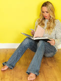Attractive Young Woman Studying Reading a Book Royalty Free Stock Images