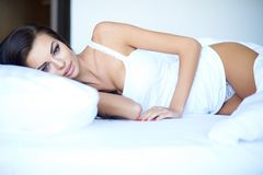 Attractive young woman suffering from insomnia Royalty Free Stock Image