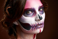 Attractive young woman with sugar skull makeup. Hallovin royalty free stock photo