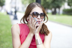 Attractive young woman in sunglasses Stock Image