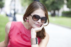Attractive young woman in sunglasses. Portrait of beautiful woman outdoor Stock Photos