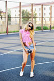 Attractive young woman in sunglasses posing outdoor - full lengt Stock Photo