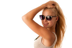 Attractive young woman with sunglasses studio isolated over whit Royalty Free Stock Photos