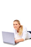 Attractive young woman surfing the internet Royalty Free Stock Photography
