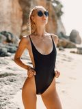 Attractive young woman in swimwear at ocean beach in Bali royalty free stock images