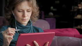 Attractive young woman with tablet in cafe, freelancer concept stock footage