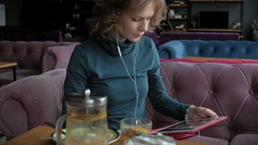 Attractive young woman with tablet in cafe, freelancer concept stock video footage