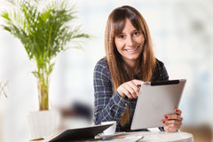 Attractive young woman with a tablet in the office Stock Images