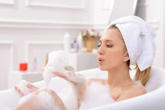 Attractive young woman taking a bath Stock Photo
