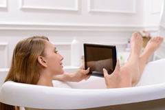 Attractive young woman taking a bath Stock Image