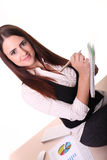 Attractive young woman taking notes in order not to forget somet. An attractive young woman taking notes to remember something in the office stock photo