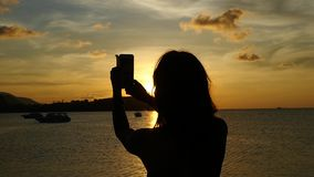 Young woman taking selfie against beautiful sunset during sea cruise. Slow Motion. Thailand. 1920x1080 stock video