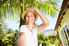 Attractive young woman taking selfie in backyard Royalty Free Stock Photo