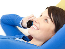 Attractive young woman talking on phone Royalty Free Stock Photo