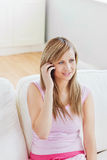 Attractive young woman talking on phone Royalty Free Stock Image