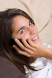 An attractive young woman talking on the phone Stock Images