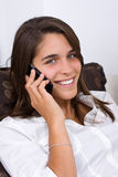 An attractive young woman talking on the phone Stock Photography