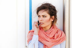 Attractive young woman talking on the phone Royalty Free Stock Images
