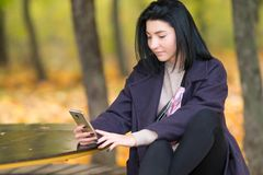 Attractive young woman texting on her mobile phone. royalty free stock photo