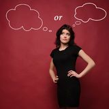 Attractive young woman thinking Royalty Free Stock Image