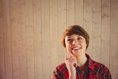 Attractive young woman thinking Royalty Free Stock Photography