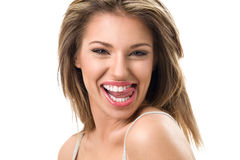 Attractive young woman with toothy smile Stock Images