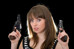 Attractive young woman with two pistol Stock Photos