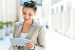 Attractive young woman using digital tablet Stock Image