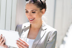 Attractive young woman using digital tablet Royalty Free Stock Photo