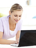 Attractive young woman using her laptop at home Stock Photos