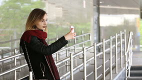 Attractive young woman using her touch screen mobile cell phone and smiling to herself stock video footage