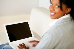 Attractive young woman using laptop Stock Images