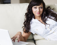 Attractive young woman using laptop Royalty Free Stock Photography