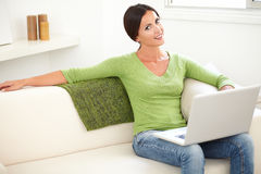 Attractive young woman using a laptop Stock Photography