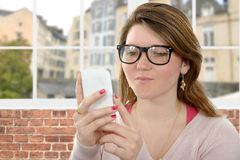Attractive young woman using phone Royalty Free Stock Images