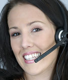 Attractive young woman using  phone headset Royalty Free Stock Photography