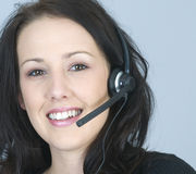Attractive young woman using  phone headset Stock Photo