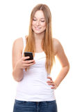 Attractive young woman using smart phone Royalty Free Stock Photos